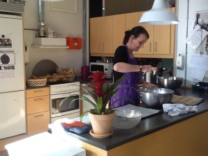 A pedagogue prepares afternoon in classroom kitchen with the children participating in the after school programme.
